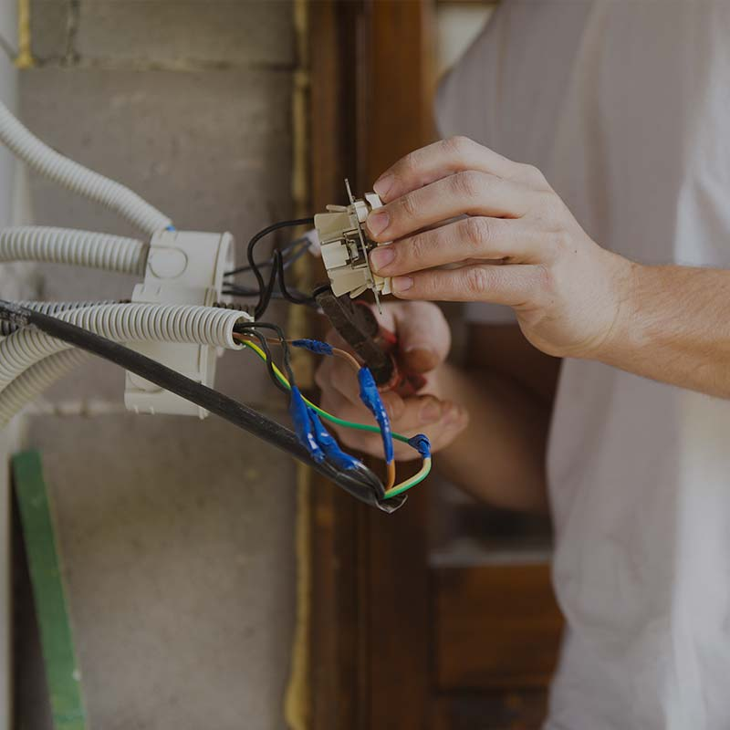 image of man inspecting electrical wiring